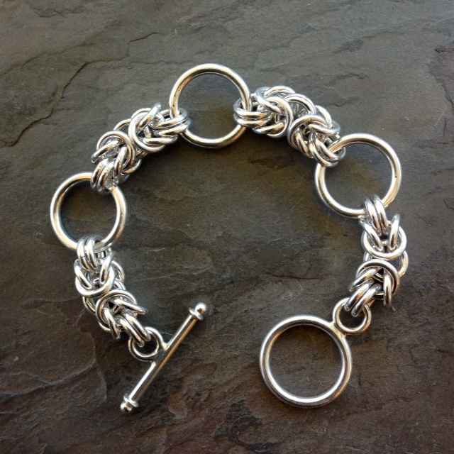 Sterling silver bracelet with Byzantine link with feature rings